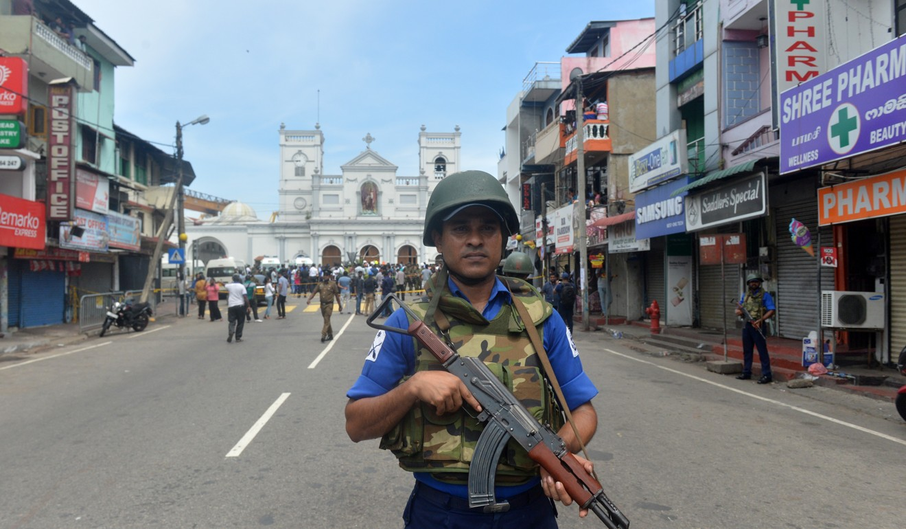 A soldier stands guard in front of the St Anthony's Church in Colombo. Photo: Xinhua