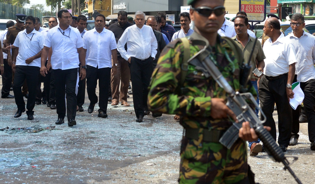 Sri Lankan Prime Minister Ranil Wickremesinghe (centre) arrives to visit the site of a bomb attack at St Anthony's Shrine in Kochchikade in Colombo on April 21, 2019. Photo: AFP