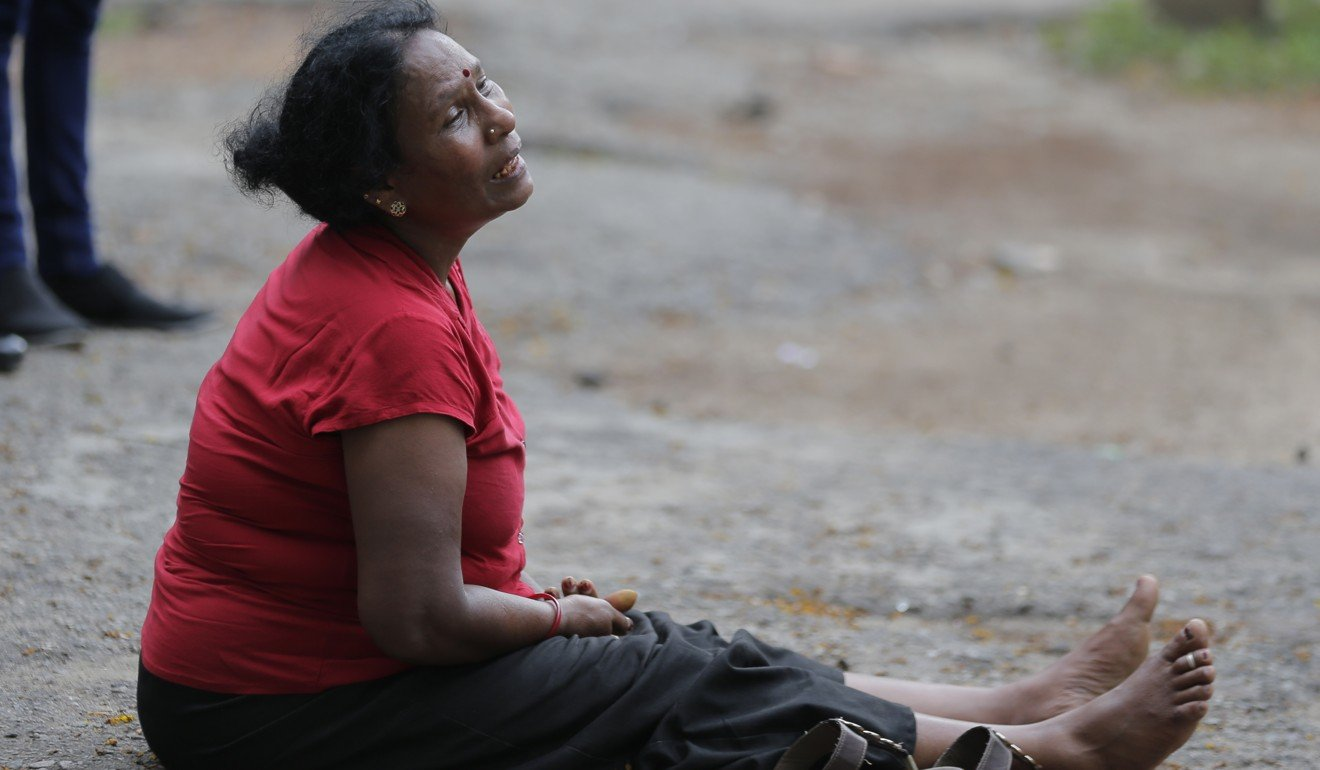 A relative of a blast victim grieves outside a morgue in Colombo. Photo: AP