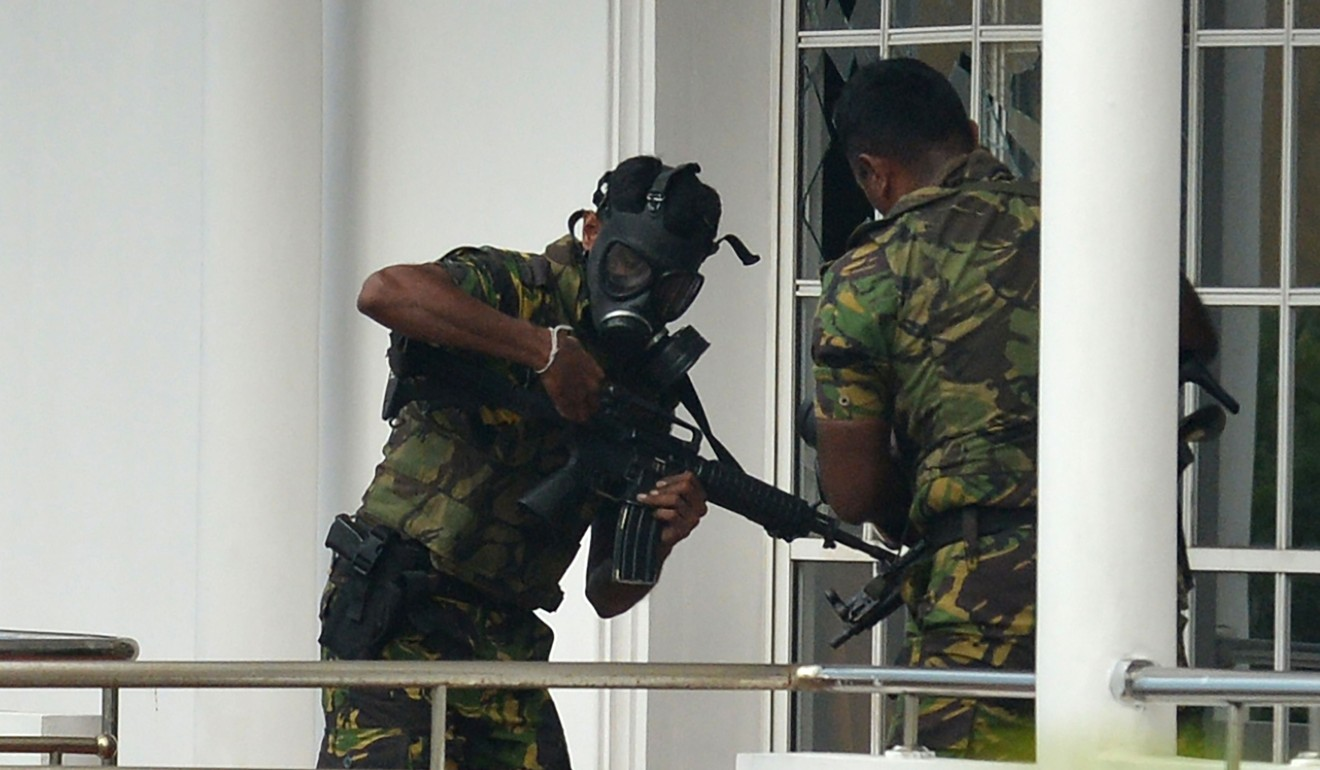 Sri Lankan Special Task Force (STF) personnel outside a house during a raid in which a suicide blast killed police searching the property in the capital Colombo. Photo: AFP