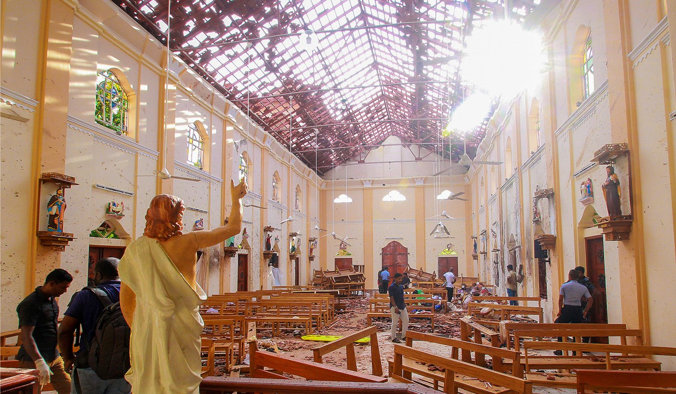 Crime scene officials inspect the site of a bomb blast inside a church in Negombo, Sri Lanka. Photo: Reuters