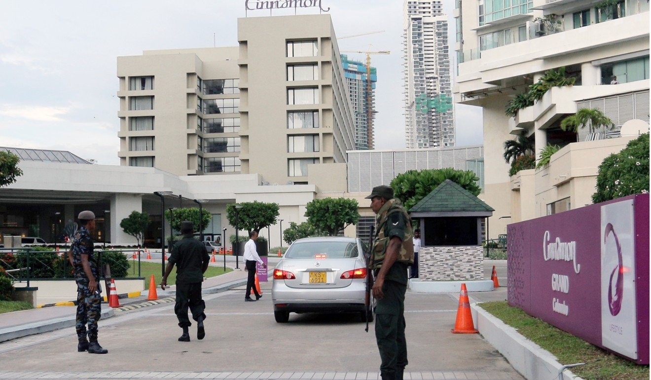 Sri Lankan military personnel inspect a vehicle outside the Cinnamon Grand Hotel in Colombo. Photo: Bloomberg