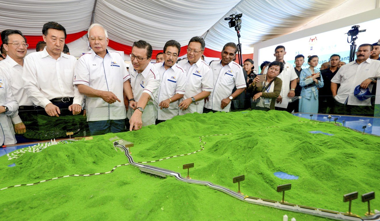 Former Malaysian Prime Minster Najib Razak, third from left, inspects a model of the proposed high-speed rail line. Photo: AP