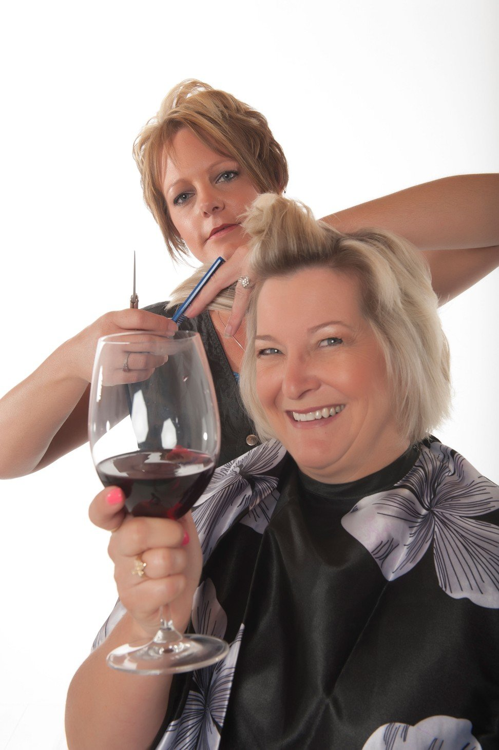 Many hairdressers, galleries and even some stores offer a glass of wine to customers. Photo: Alamy
