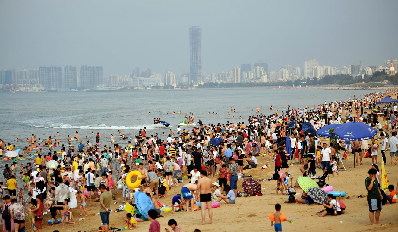 Tourists enjoy the first day of China's four-day May holiday on a beach in Haikou, Hainan province, southern China. Photo: Xinhua