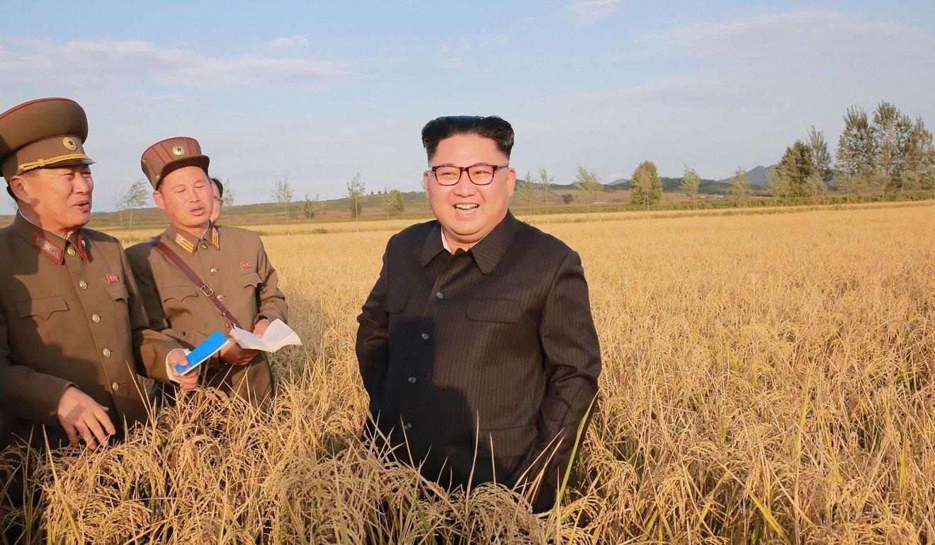North Korean leader Kim Jong-Un visits a farm in 2017. Photo: AFP