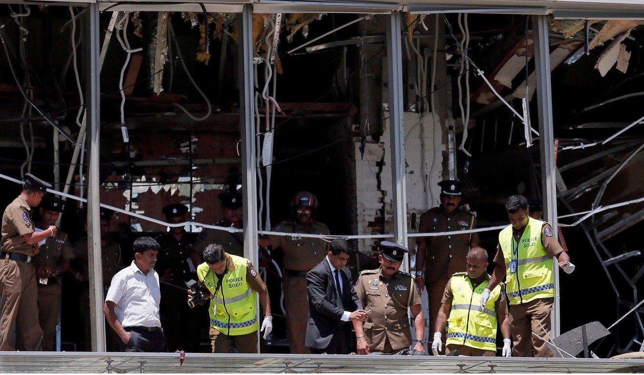 Officials inspect the site of an explosion at Shangri-La hotel in Colombo on April 21. Photo: Reuters