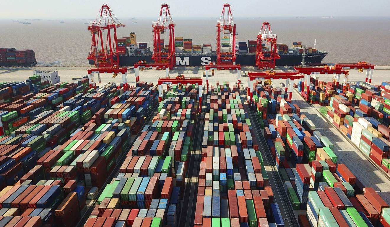 A cargo ship is seen docked at the Yangshan container port in Shanghai. Photo: AP