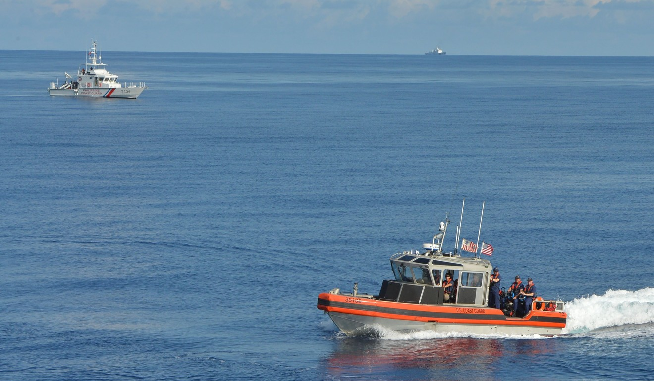 US and Philippine coastguard vessels during a joint operation near the Scarborough Shoal. Photo: AFP