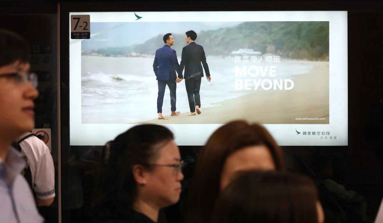 Cathay Pacific advert showing same-sex couple holding hands and the reaction by Hong Kong Airport Authority and MTR operator shows how city lags behind on LGBT rights