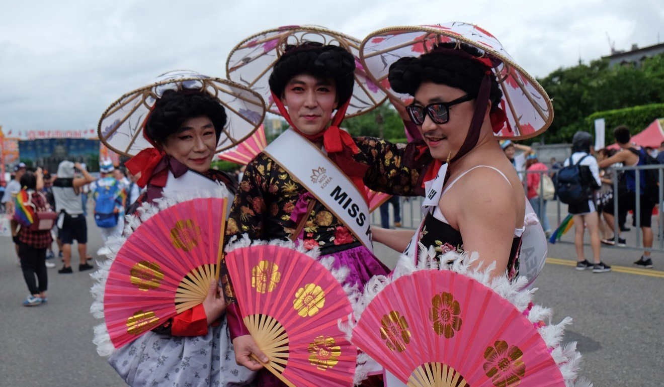 South Korean men take part in Taiwan's annual LGBT pride parade in Taipei. Photo: AFP