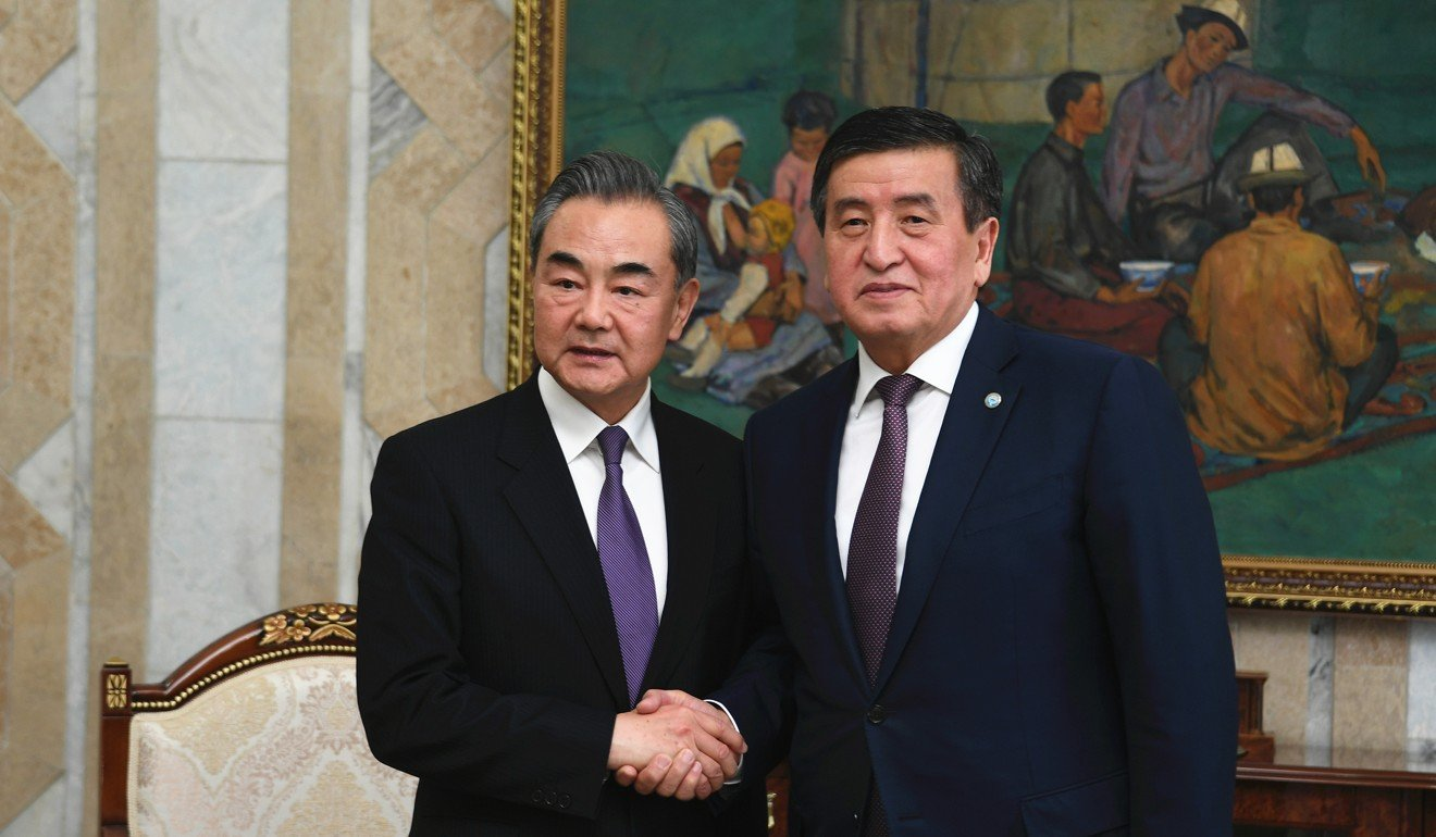 Kyrgyz President Sooronbay Jeenbekov (right) meets Chinese Foreign Minister Wang Yi in Bishkek on Tuesday last week. Photo: Xinhua