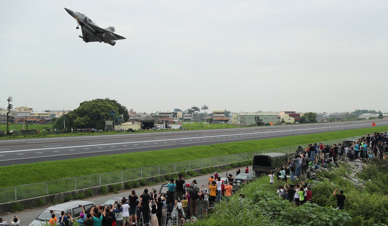 A Mirage 2000-5 fighter jet takes off from a highway during an emergency take-off and landing drill in Changhua, Taiwan. Photo: EPA