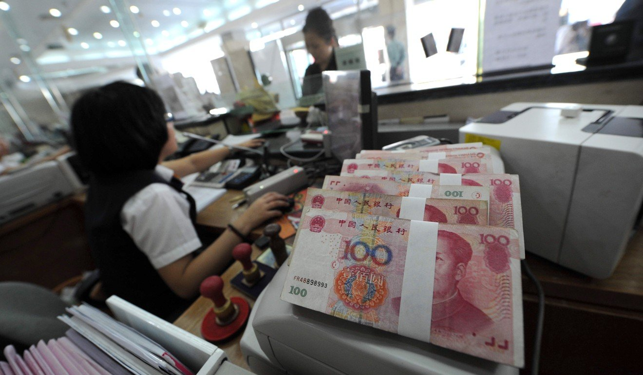 Chinese law allows citizens to withdraw a maximum of US$50,000 a year. Photo: AFP