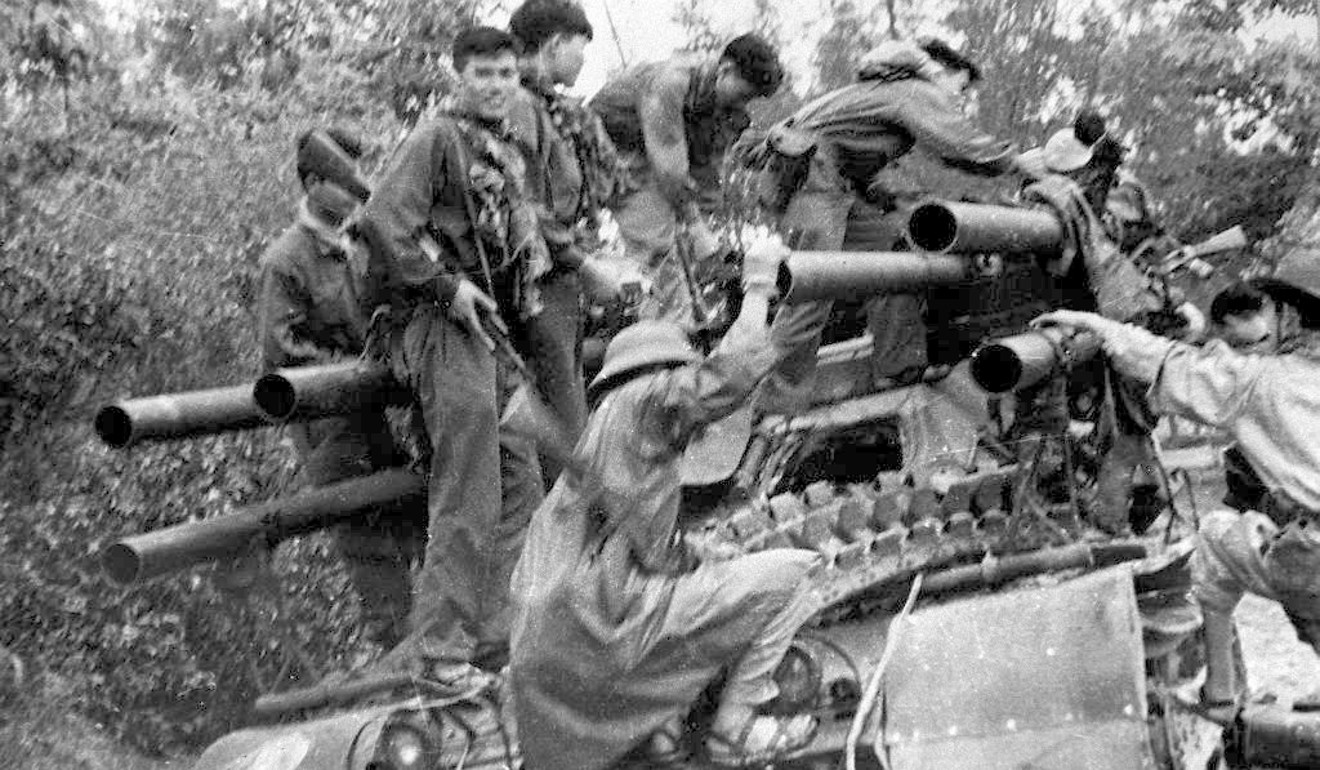 Vietcong soldiers atop an abandoned US tank in 1968, around the time that Atkinson and Jackson moved their base of operations to Bangkok. Photo: AFP