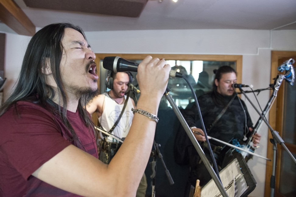 Jaya sings as Enkhush (centre) and Gala play morin khuurs, at their studio in Ulan Bator. Photo: Zigor Aldama