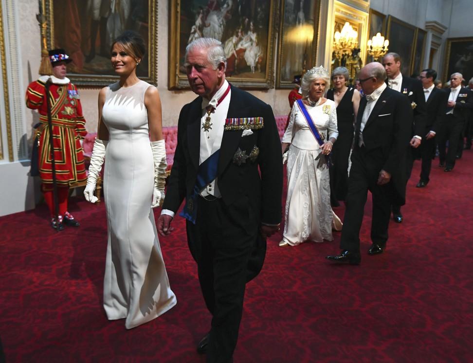 Donald Trump calls Queen Elizabeth a 'great, great woman' as British monarch hosts lavish banquet for US president's London visit