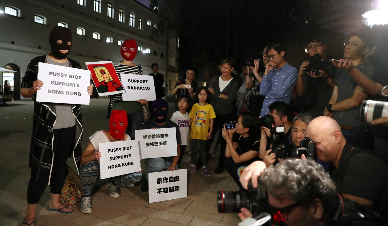 China's Banksy', cartoonist Badiucao, drops his mask to mark