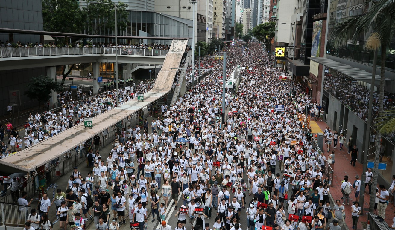 The streets are awash with white, the colour organisers asked protesters to wear. Photo: Winson Wong