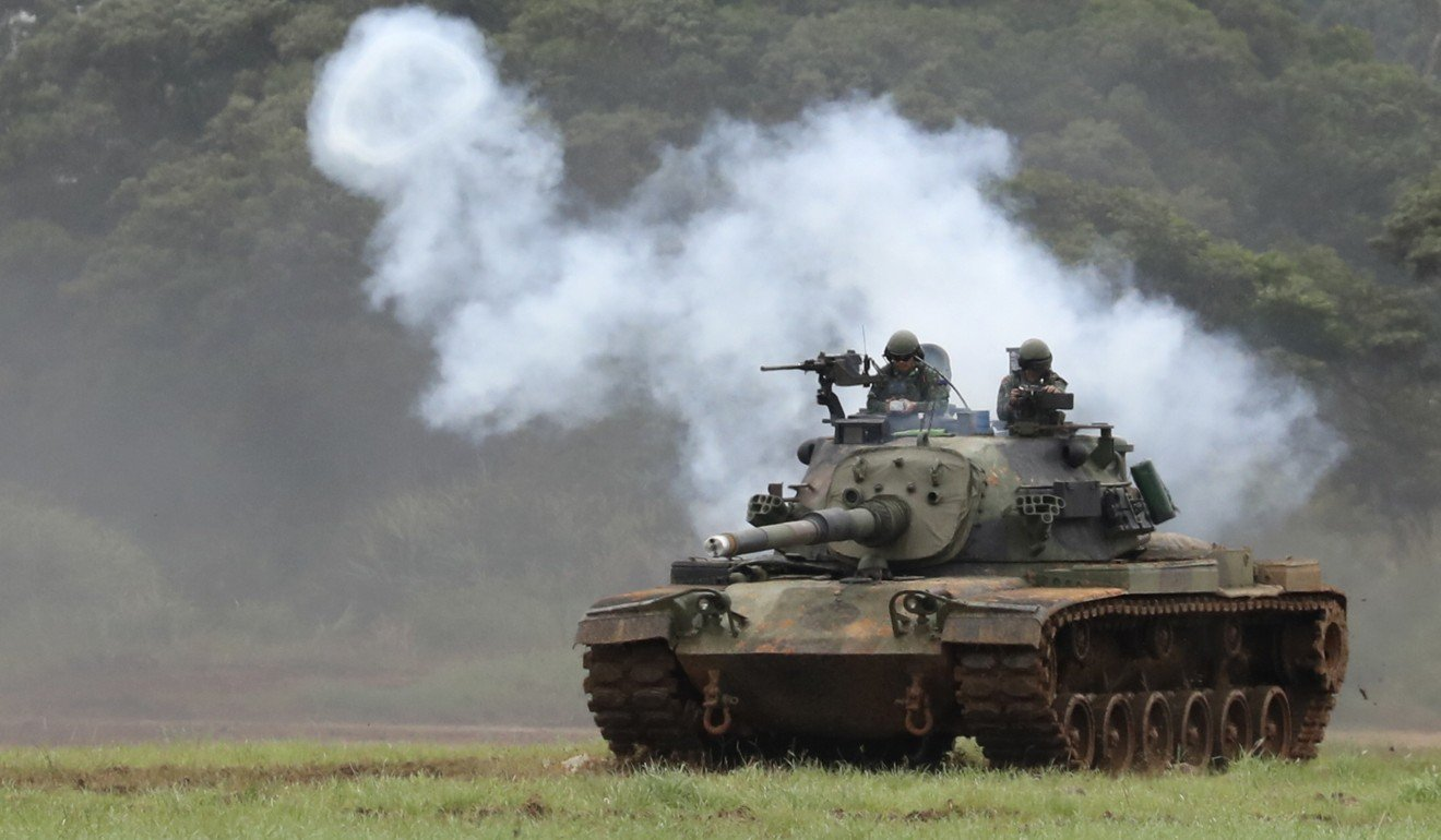 Taiwanese Soldiers on a CM11 battle tank, jointly developed with US arms manufacturer General Dynamics. Photo: EPA