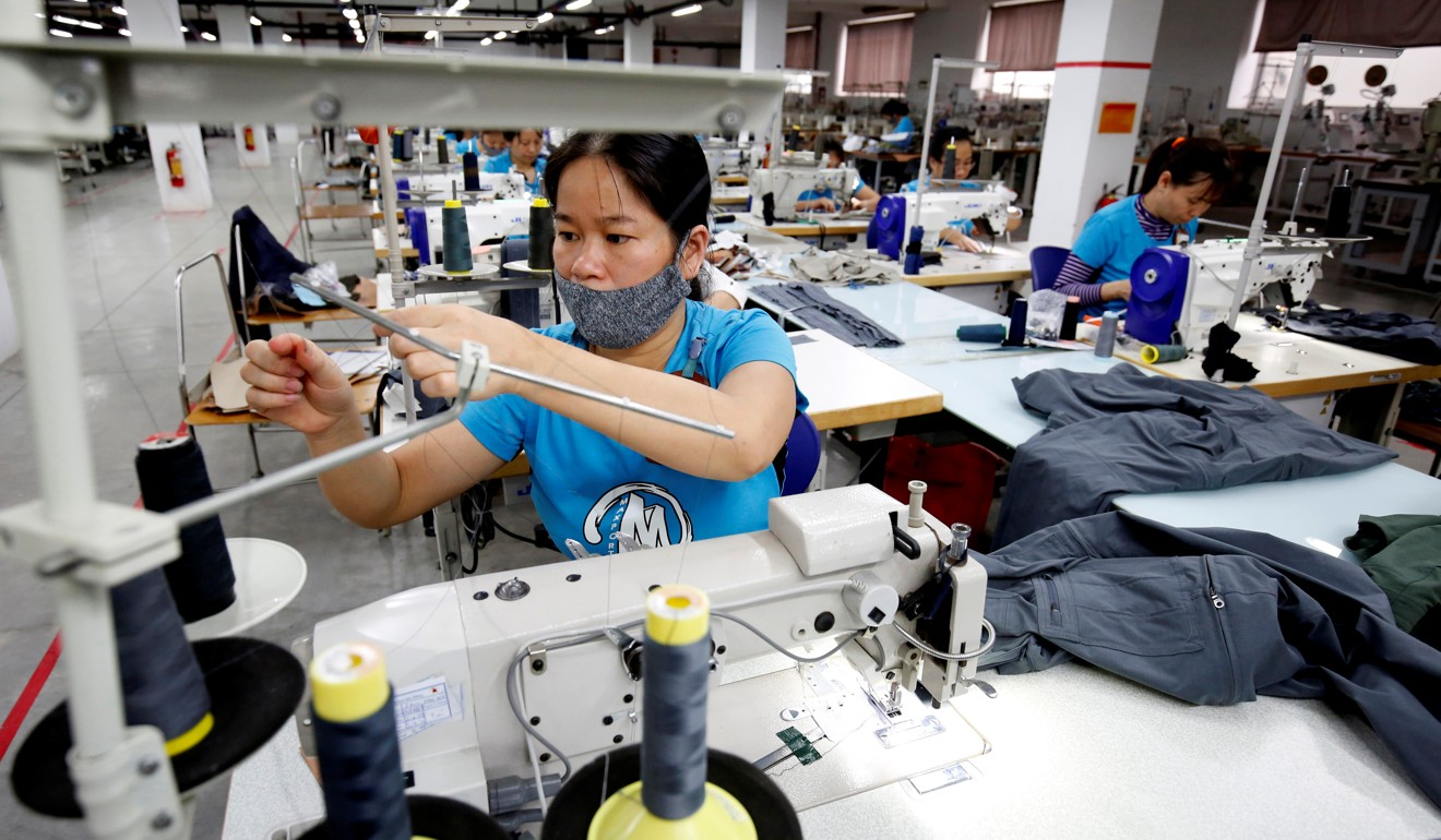 Labourers work at an export garment factory in Hanoi, Vietnam, on March 20. To meet the growing demand, Vietnam needs 96,500 megawatts of electricity by 2025. Photo: Reuters
