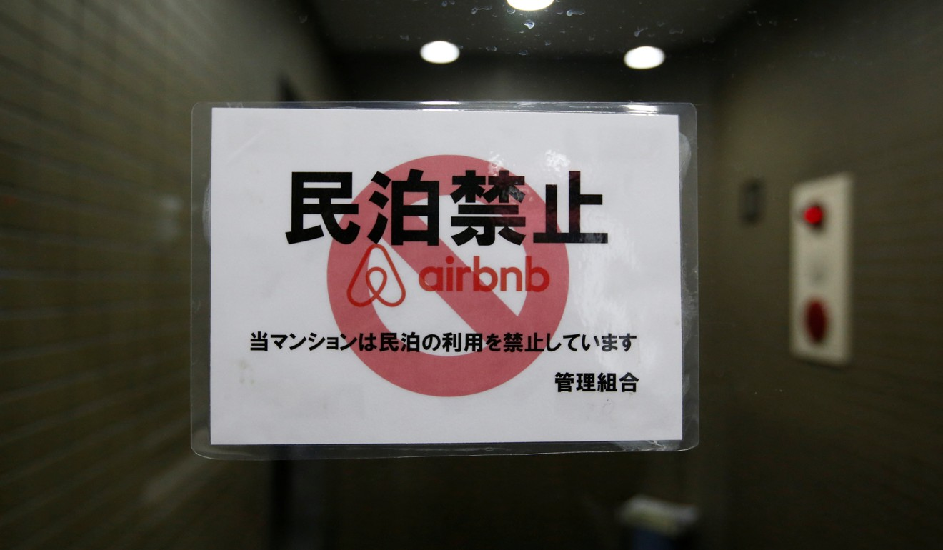 A sign on the door to a block of flats in Tokyo communicating a ban on using units in the property for Airbnb, in March 2018. Photo: Reuters