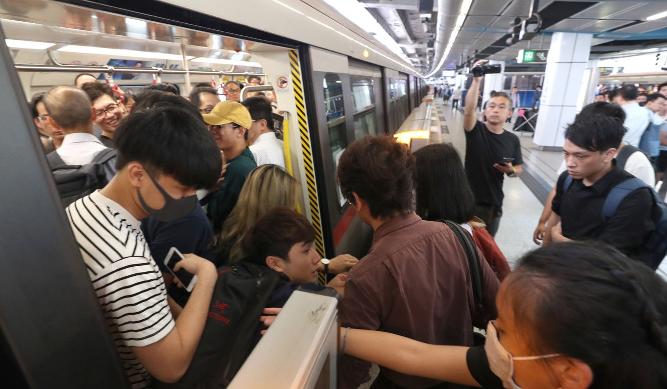 Protesters disrupt Hong Kong's MTR train services with non