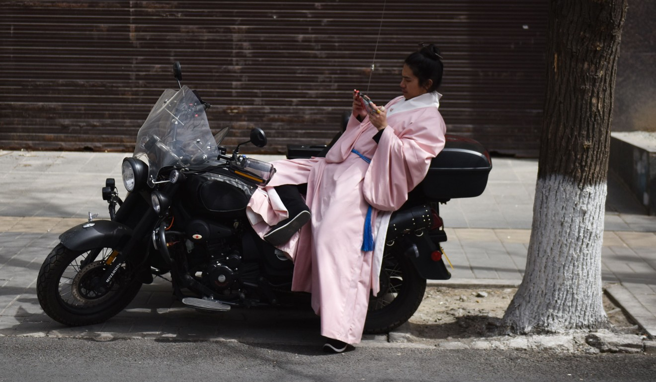 Fans of traditional Chinese clothing dare to mix old and new, and hanfu is not the preserve of women. Photo: AFP