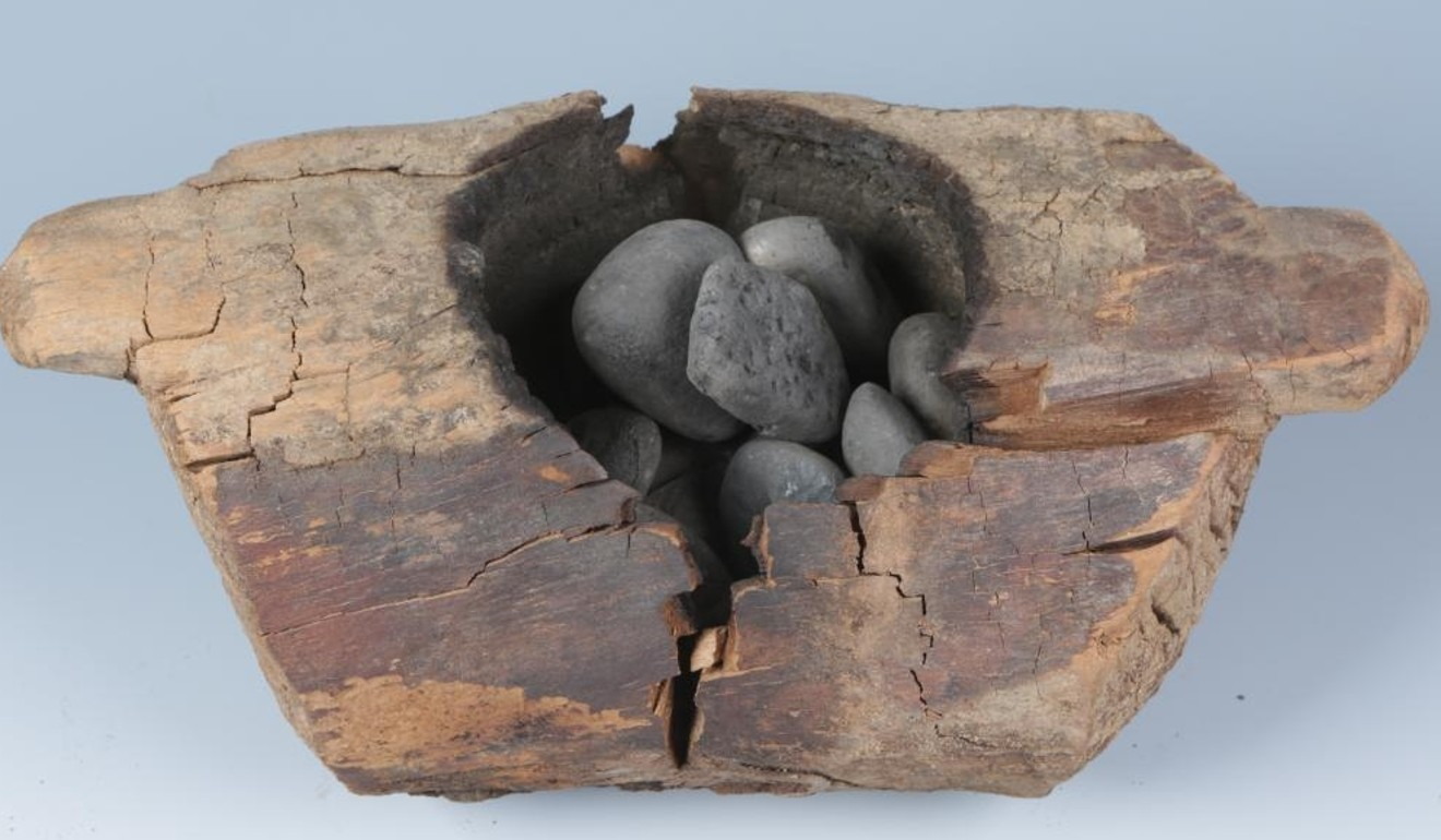 Scientists in Xinjiang found hemp had been burned on stones inside these wooden bowls 2,500 years ago. Photo: Chinese Academy of Sciences and Max Planck Institute