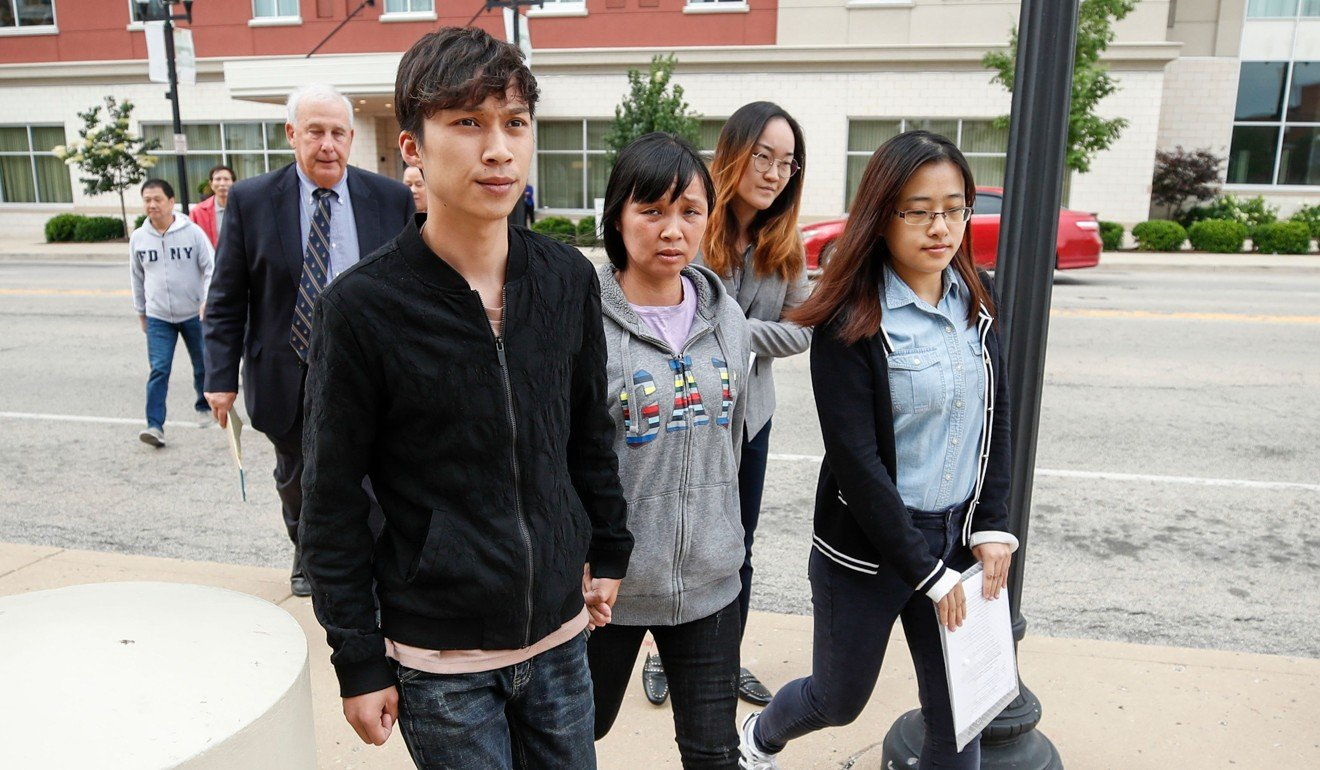 Zhang Yingying's mother, Ye Lifeng (front centre), and brother Zhang Zhengyang (front left) arrive at the courthouse on Wednesday. Photo: AFP