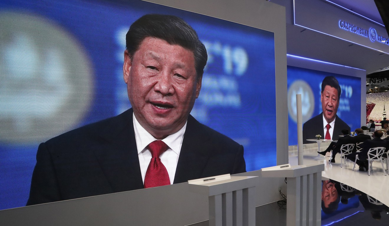 """Screens show Chinese President Xi Jinping speaking at an international economic forum in St. Petersburg, Russia on June 7. Xi has called for the construction of an """"innovation-driven economy"""" to make China a global innovation leader by 2035. Photo: EPA-EFE"""