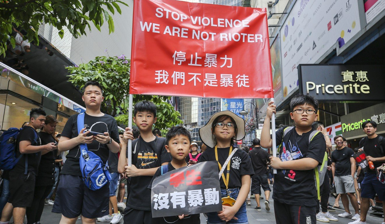 Some youthful demonstrators make their feelings known in Causeway Bay. Photo: Winson Wong