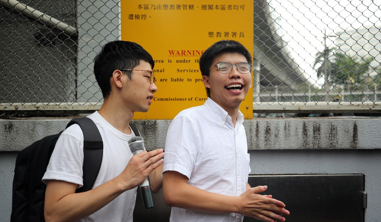Pro-democracy student activist Joshua Wong leaves Hong Kong prison after serving one month of two-month sentence