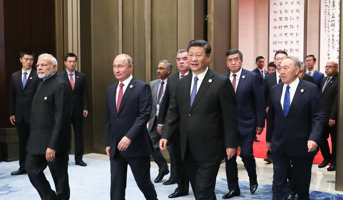 Chinese President Xi Jinping leads other leaders of Shanghai Cooperation Organisation: Russia's Vladimir Putin and India's Narendra Modi at the 2018 summit. Photo: Xinhua