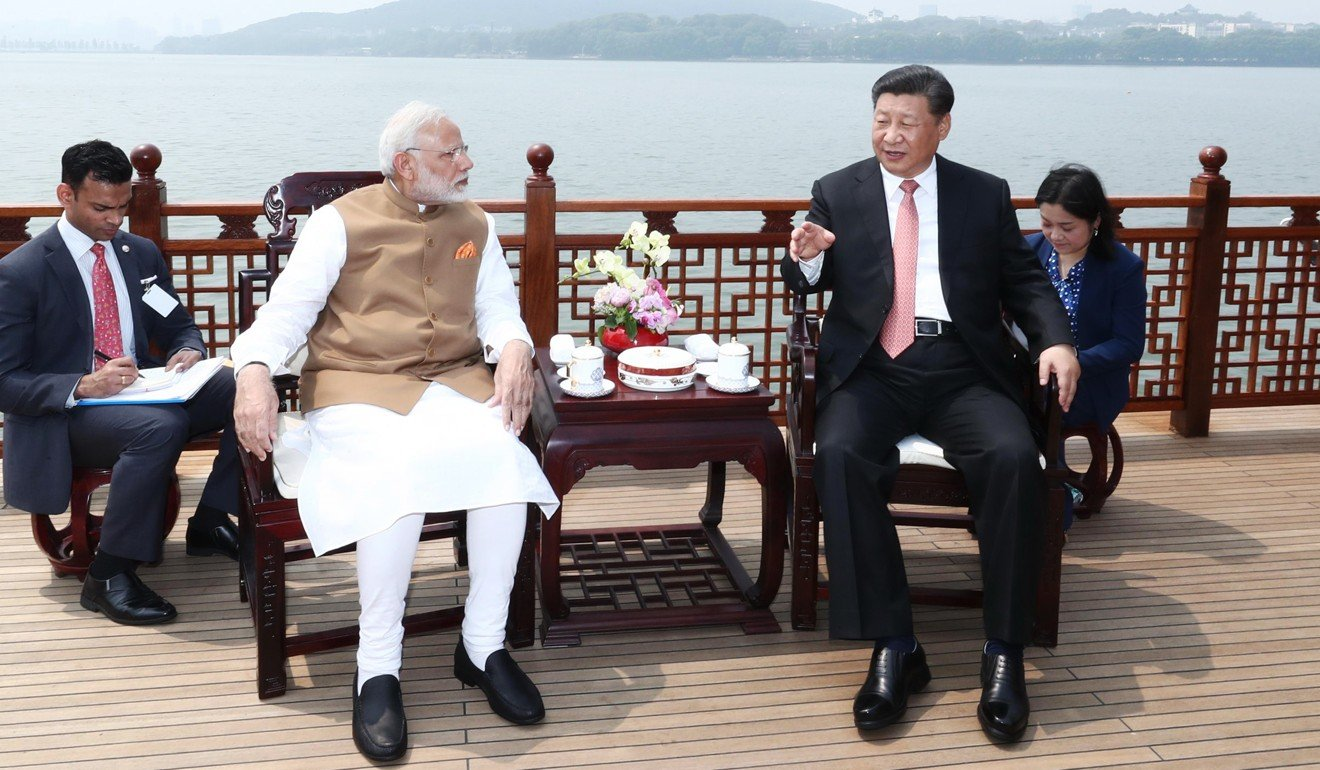 Indian Prime Minister Narendra Modi speaks with Chinese President Xi Jinping in Wuhan. Photo: Xinhua