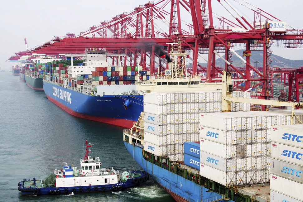 A barge pushes a container ship to the dockyard in Qingdao in eastern China's Shandong province. Qingdao is one of the North's most important cities, economically, but Shandong province as a whole is losing people to economic migration at an alarming rate. Photo: AP