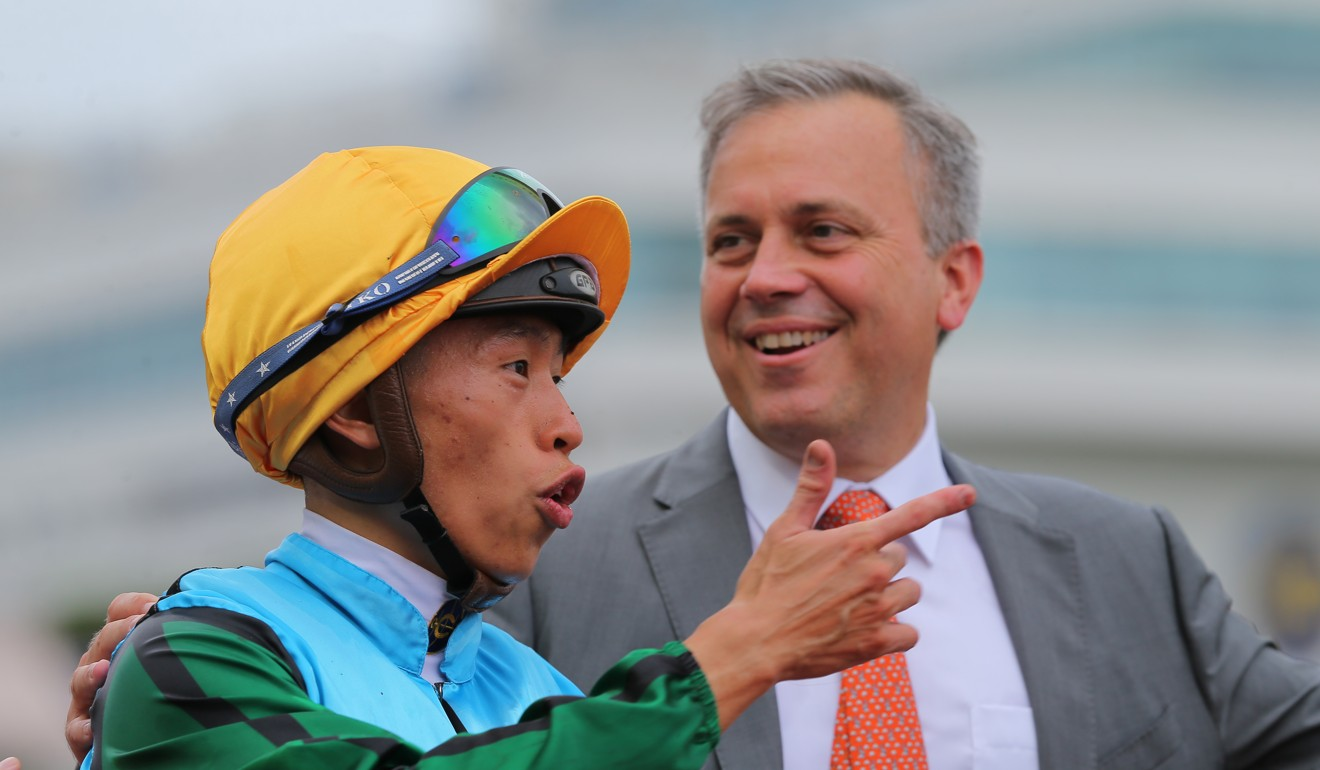 Trainer Caspar Fownes and jockey Vincent Ho enjoy Rise High's win.