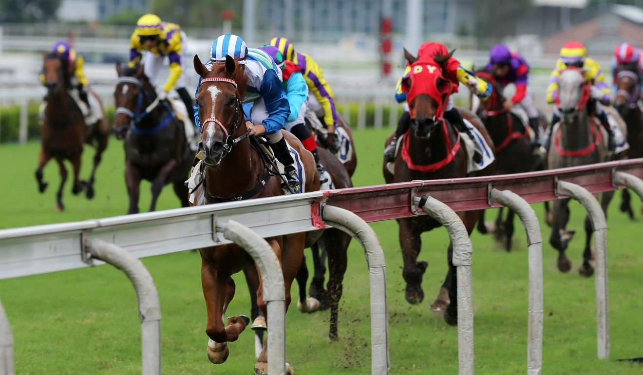 Voyage Warrior races down the outside rail to win easily at Sha Tin on Sunday.