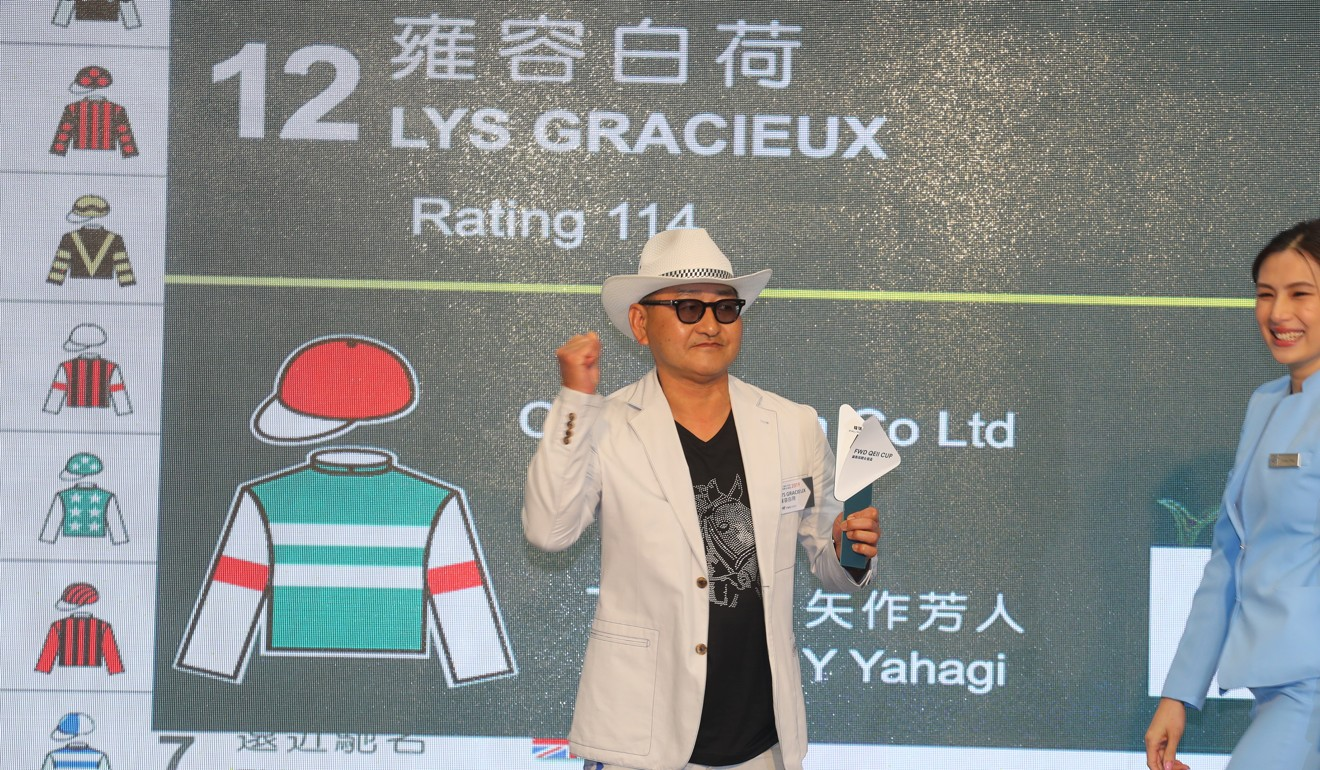 Trainer Yoshito Yahagi draws the Barrier 4 for The QEII Cup runner Lys Gracieux in the Champions Day Barrier Draw at Sha Tin.