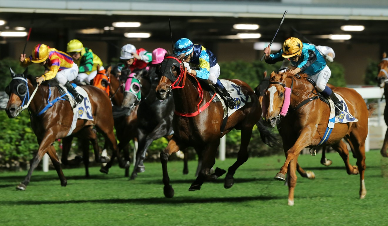 True Grit (middle) bursts out of the pack to win at Happy Valley last start.