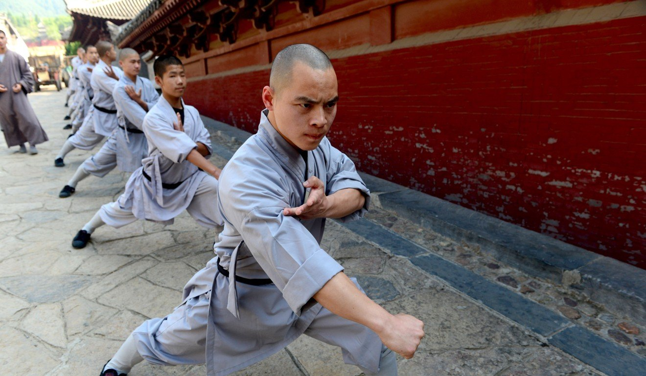 Monks practise kung fu at Shaolin Temple in Dengfeng, Henan province, in April 2016. Photo: Xinhua