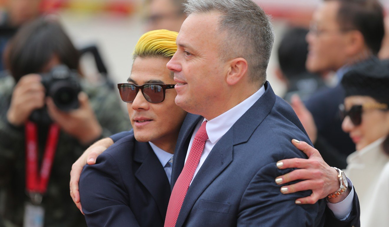 Aaron Kwok embraces trainer Caspar Fownes after the win of Dancing Fighter.