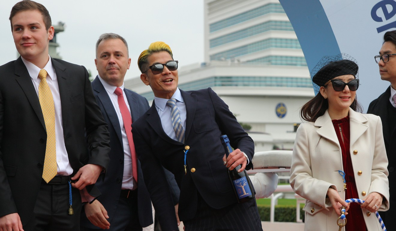 Caspar Fownes celebrates the victory of Dancing Fighter with his owner Aaron Kwok.