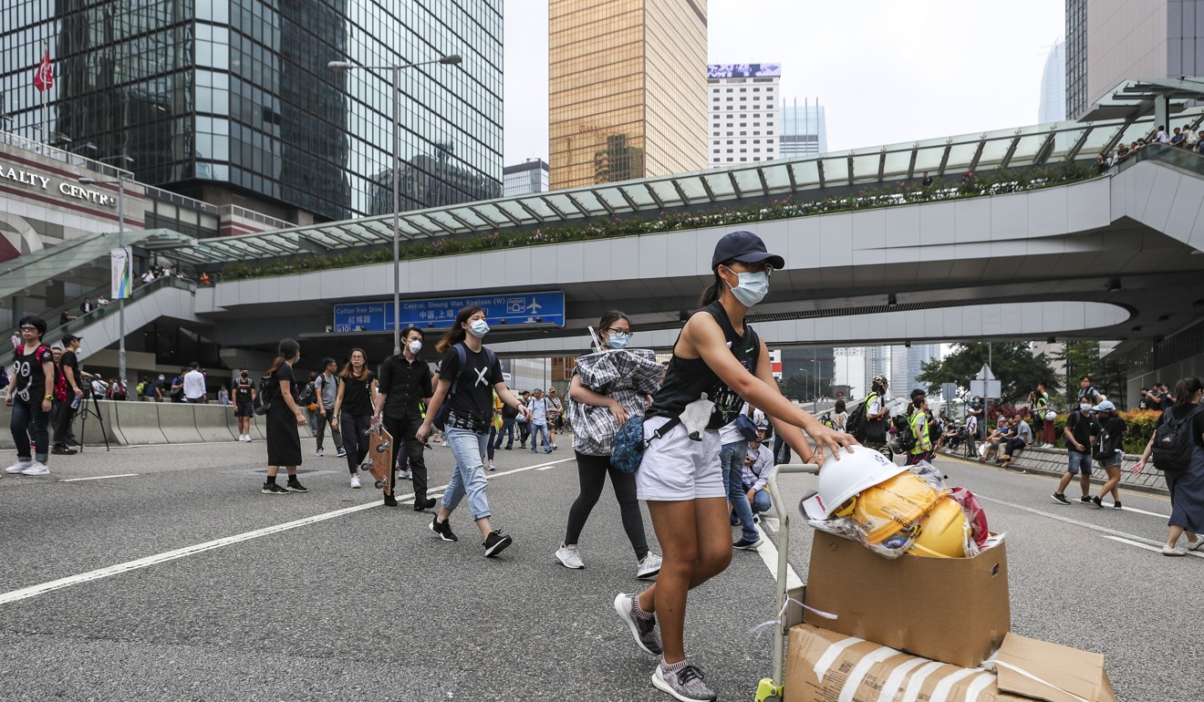 Young people shift equipment in Harcourt Road on June 17 that is often shared around at protests. Photo: Sam Tsang