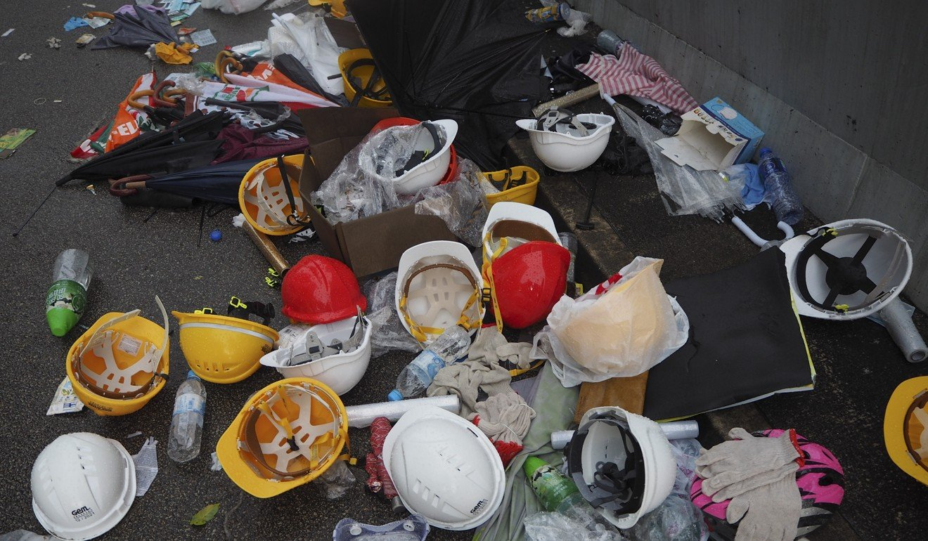 Helmets lie strewn across the road the day after extradition bill protests on June 12 in Admiralty. Photo: Antony Dickson