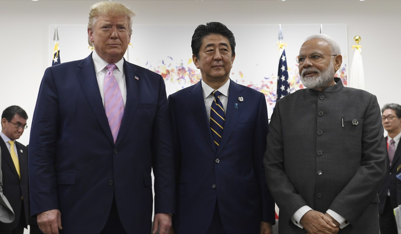(From left) US President Donald Trump, Japanese Prime Minister Shinzo Abe and Indian Prime Minister Narendra Modi pose for a photo before their meeting. Photo: AP