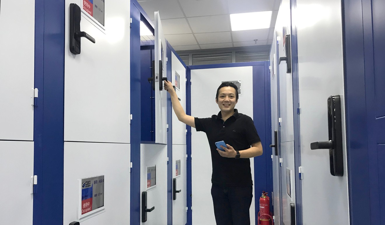 Alan Tso, founder of CBD self-storage, shows how customers open lockers with digital keys. Photo: Kimmy Chung