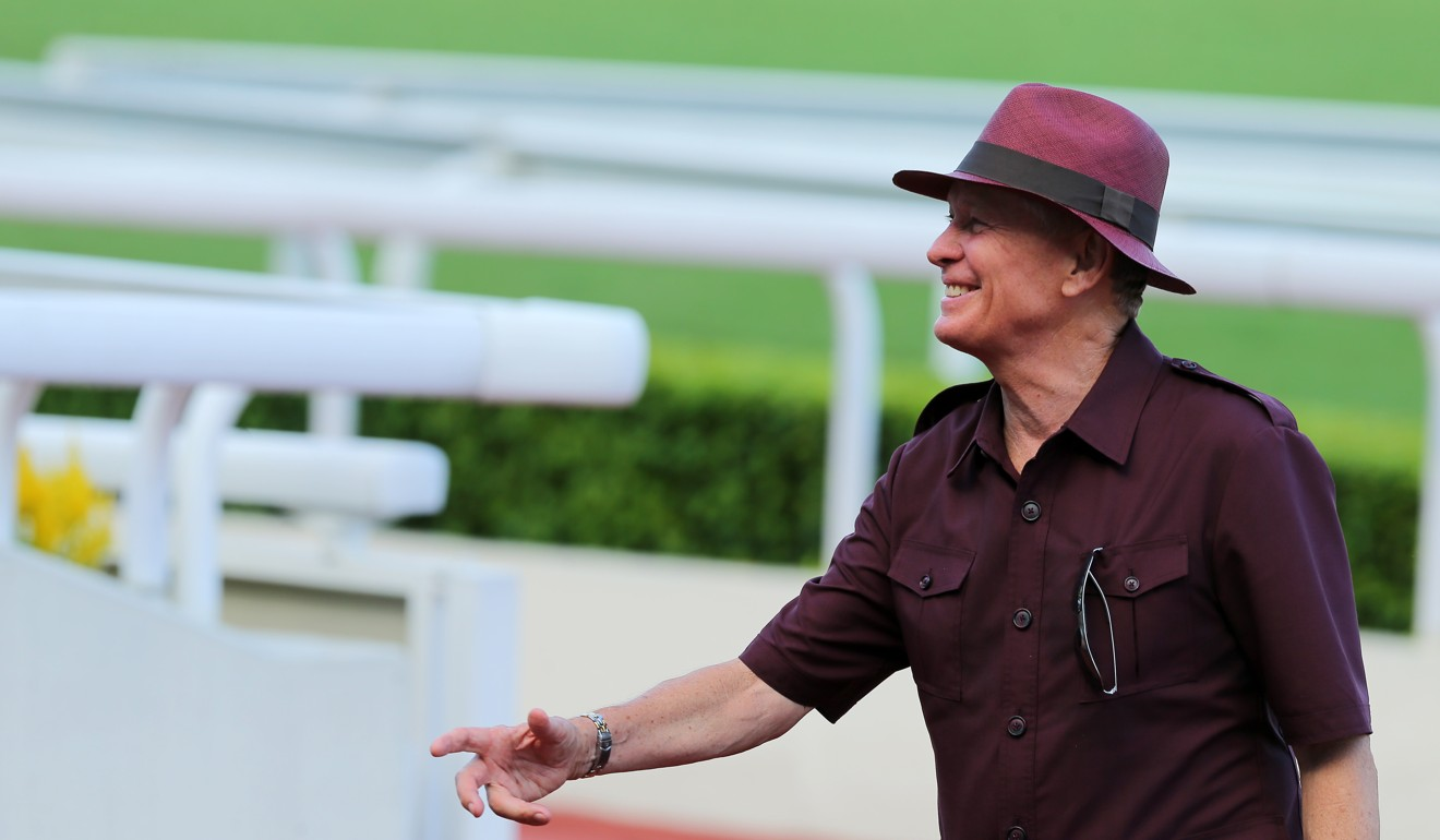 John Moore shares a laugh after training another winner at Sha Tin this season.