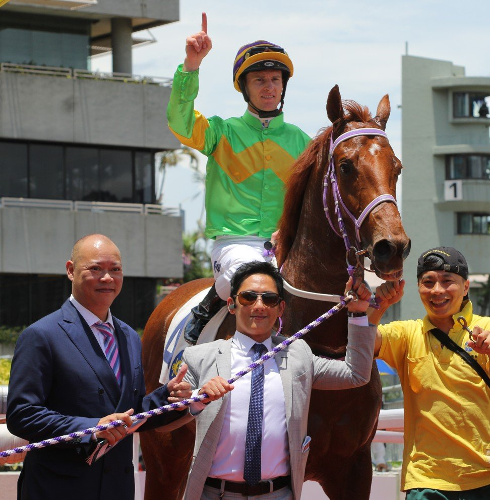 Chris So (left) celebrates Classic Unicorn's win.