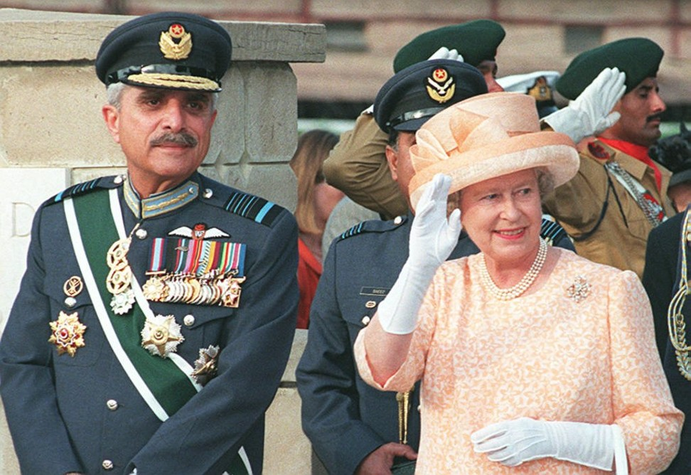 Queen Elizabeth waves to crowds at the Commonwealth War Graves Cemetery in Rawalpindi, 30km from Islamabad, in October 1997. Photo: AFP